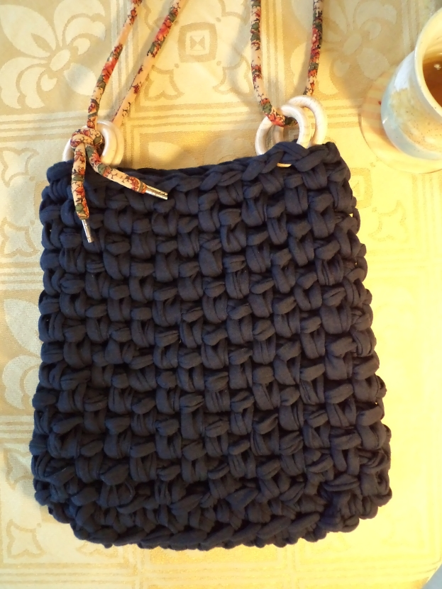 black fabric yarn handbag