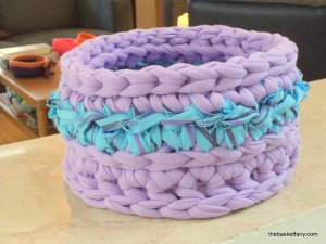 Crochet basket with recycled fabric trim